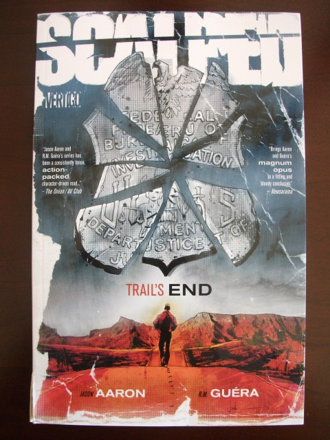 "Scalped, Volume 10: Trail's End. From the DC Comics description: ""Fifteen years ago, Dashiell ""Dash"" Bad Horse ran away from a life of poverty and hopelessness on the Prairie Rose Indian Reservationin search of something better. Now he's come back home armed with nothing but a set of nunchucks, a hell-bent-for leather attitude and one dark secret, to find nothing much has changed on ""The Rez"" -- short of a glimmering new casino run by a corrupt leader named Red Crow, and a once-proud people overcome by drugs and organized crime.!"""